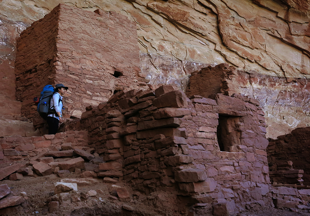 Britnee Johnston visits an ancient ruin while backpacking in Grand Gulch. Photo by Mark Johnston.