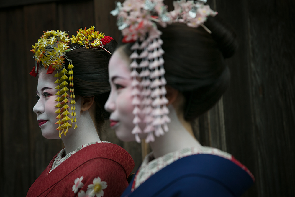 Tourists dress as geishas in Kyoto's famous Gion district