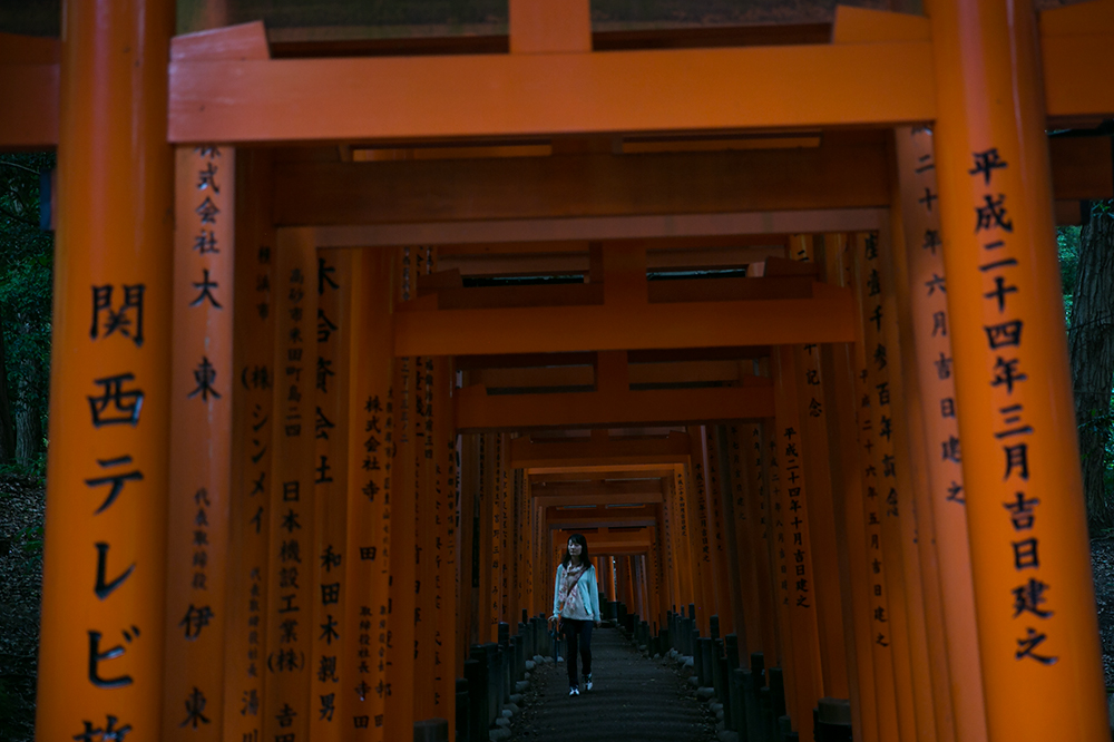 Visiting Fushimi Inari Shrine in historic Kyoto, Japan. Red gates. Red gates in Kyoto.