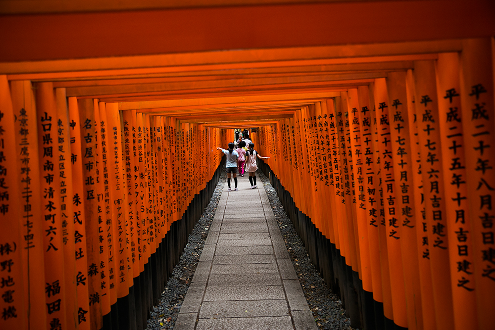 Visiting Fushimi Inari Shrine in historic Kyoto, Japan.