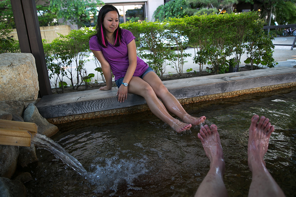 Enjoying one of two free foot baths in downtown Takayama. Wonderful hot springs for tired, over-walked feet.
