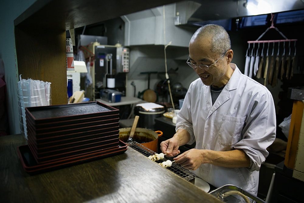 Iwasaki-San preparing traditional Japanese sweets for us in his store.