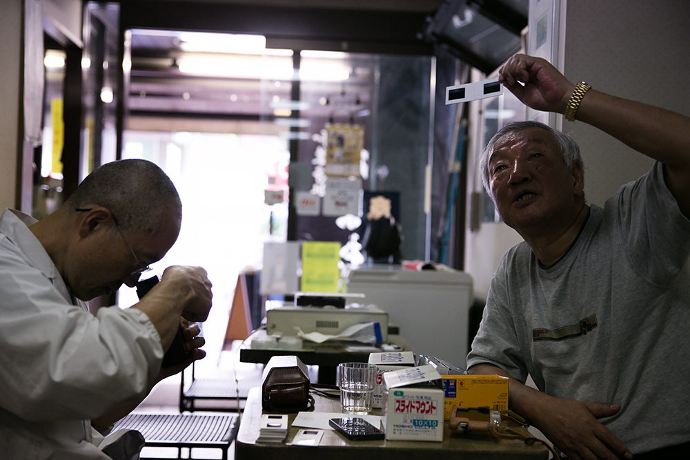 Iwasaki-San and Yamagata-San while we admire their collection of 3D slides they shot on Kodak Stereo cameras.