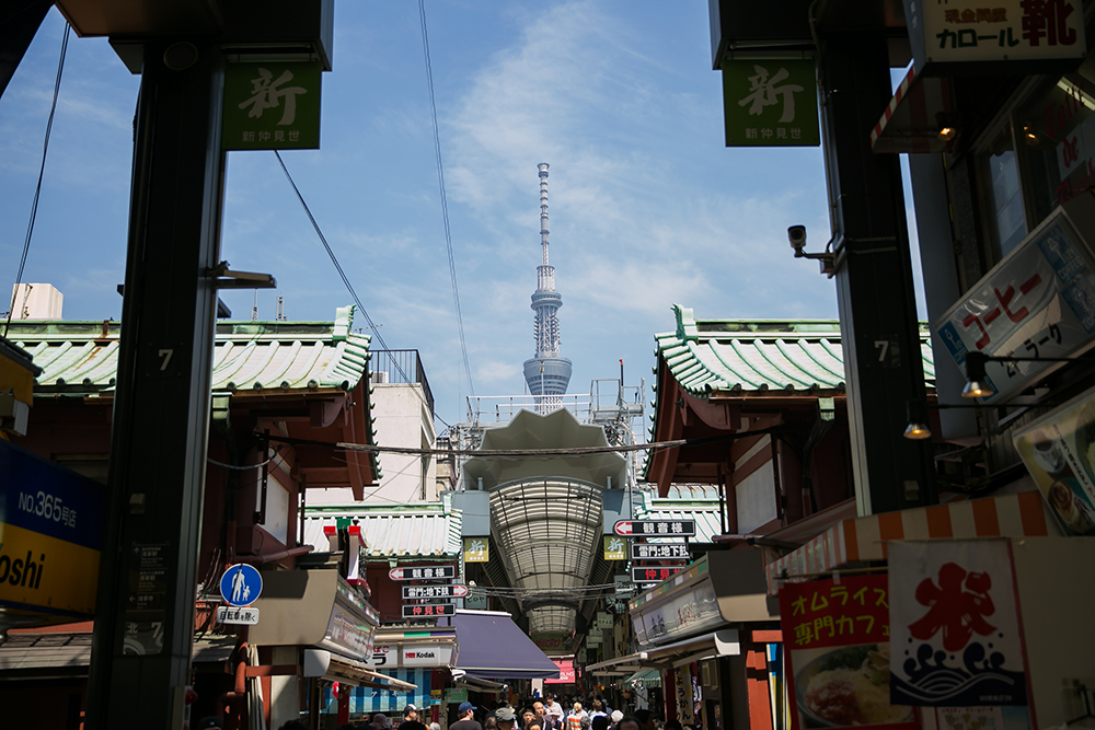 Spot the SkyTree. Shopping in Nakamise, a shopping street that leads to the Sensoji temple in Asakusa, Japan.