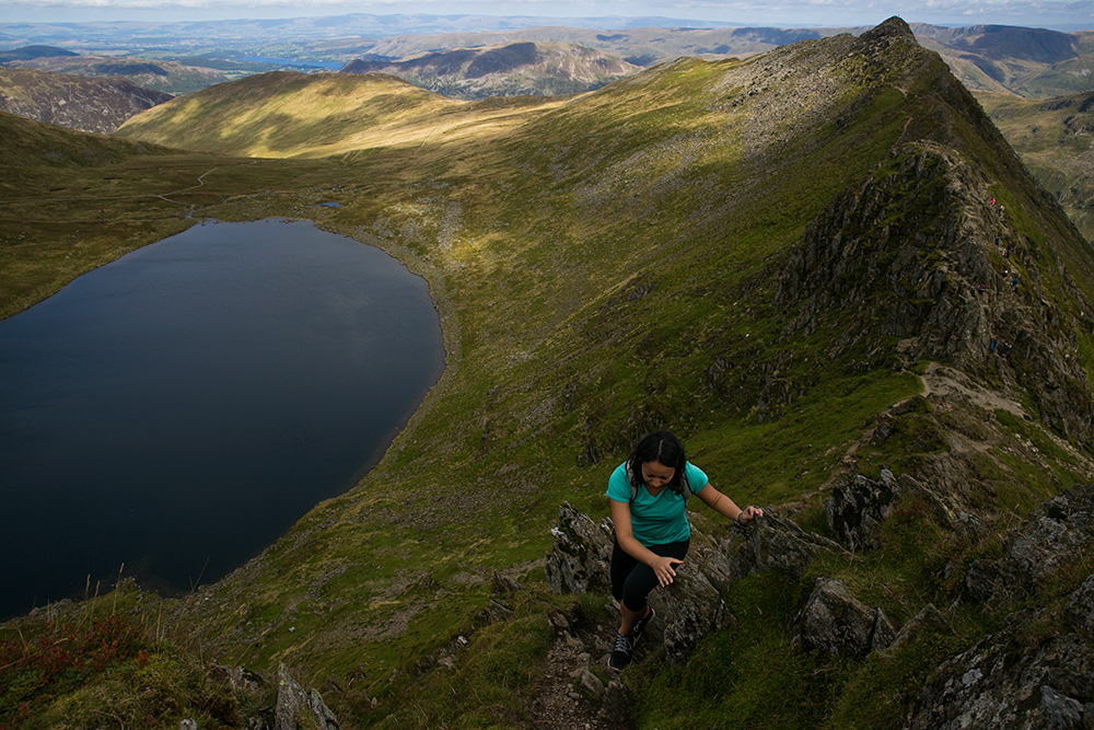 Hiking Striding Edge up Helvellyn in the Lake District, England.