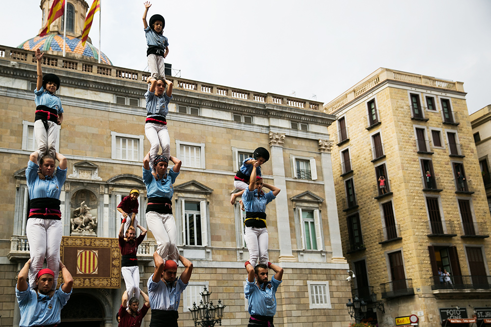 Building castells in the streets of Barcelona, Spain