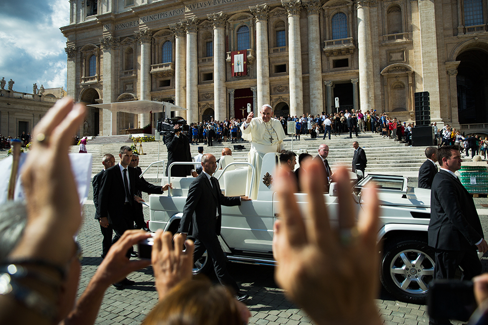 Pope Francis greets a crowd from the Pope Mobile after Sunday mass at the Vatican City