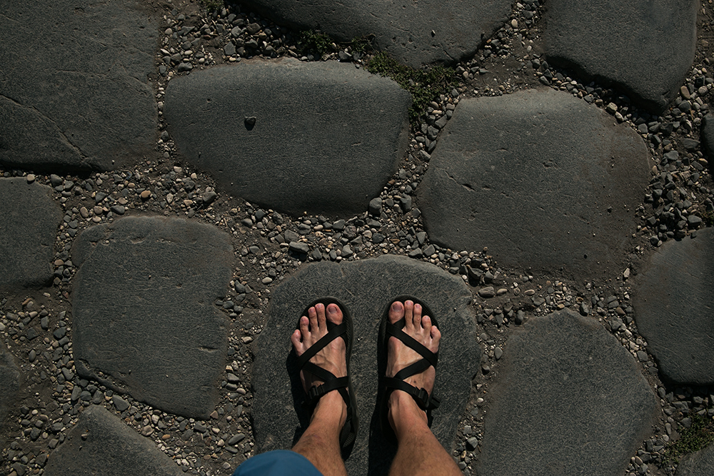 Chaco sandals on Roman ruins in Rome, Italy