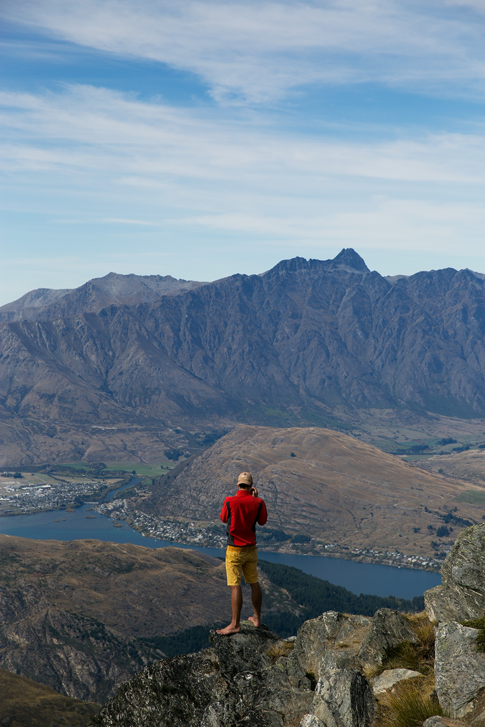 A hiker takes in the view of Queenstown from Ben Lomond.