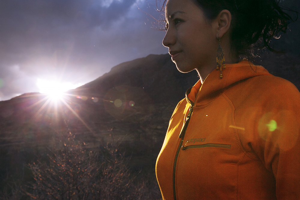 Britnee staying warm in her Cotopaxi jacket at sunset in Torres del Paine, Chile.