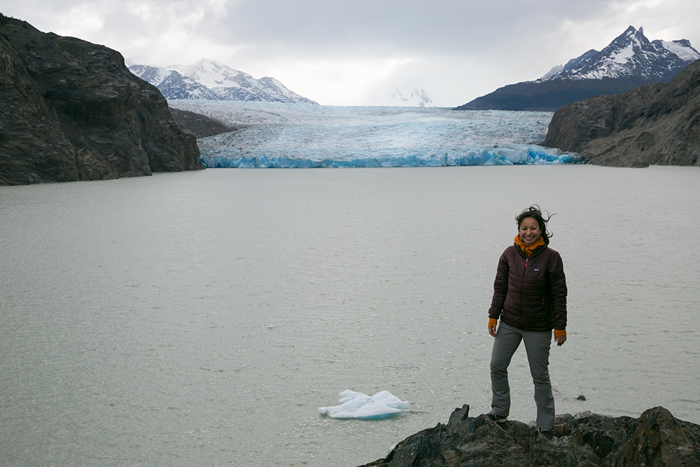 Britnee braves the wind for a photo before Glacier Grey in Torres del Paine, Chile.
