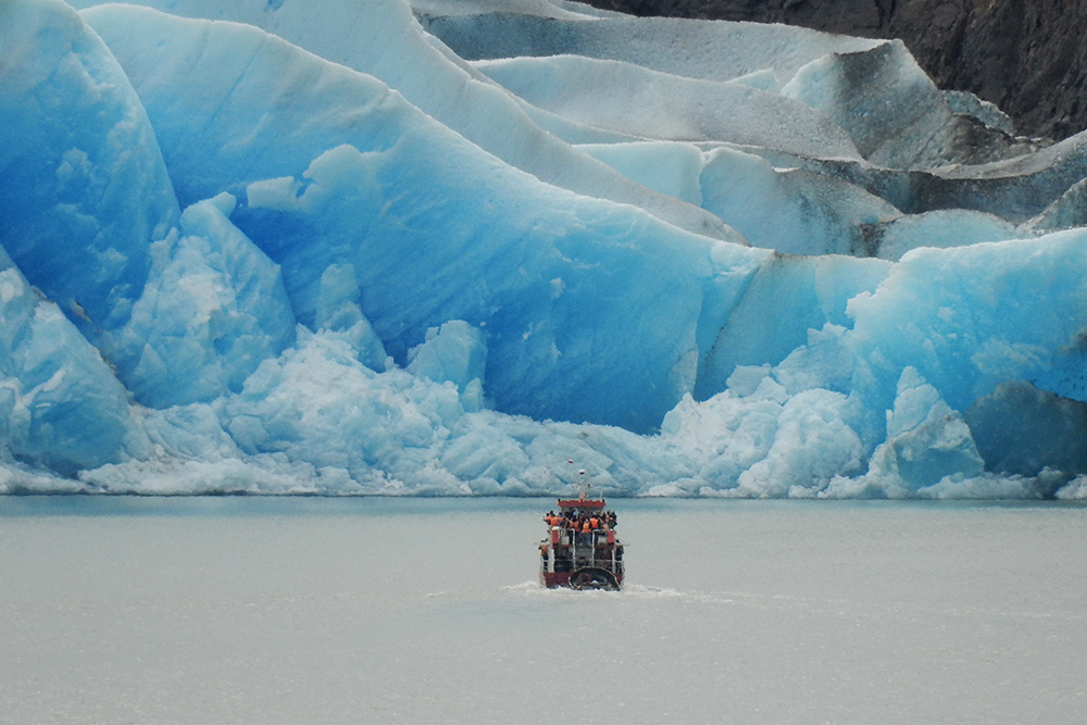 A ferry takes passengers close to the towering ice of Glacier Grey in Torres del Paine, Chile. The zoom on Britnee's Nikon Coolpix S9700 is amazing!