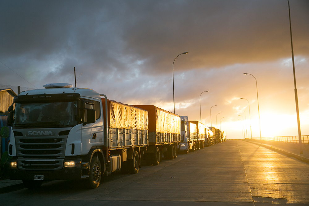 Trucks line up at the closed ferry crossing on Tierra del Fuego, Chile.