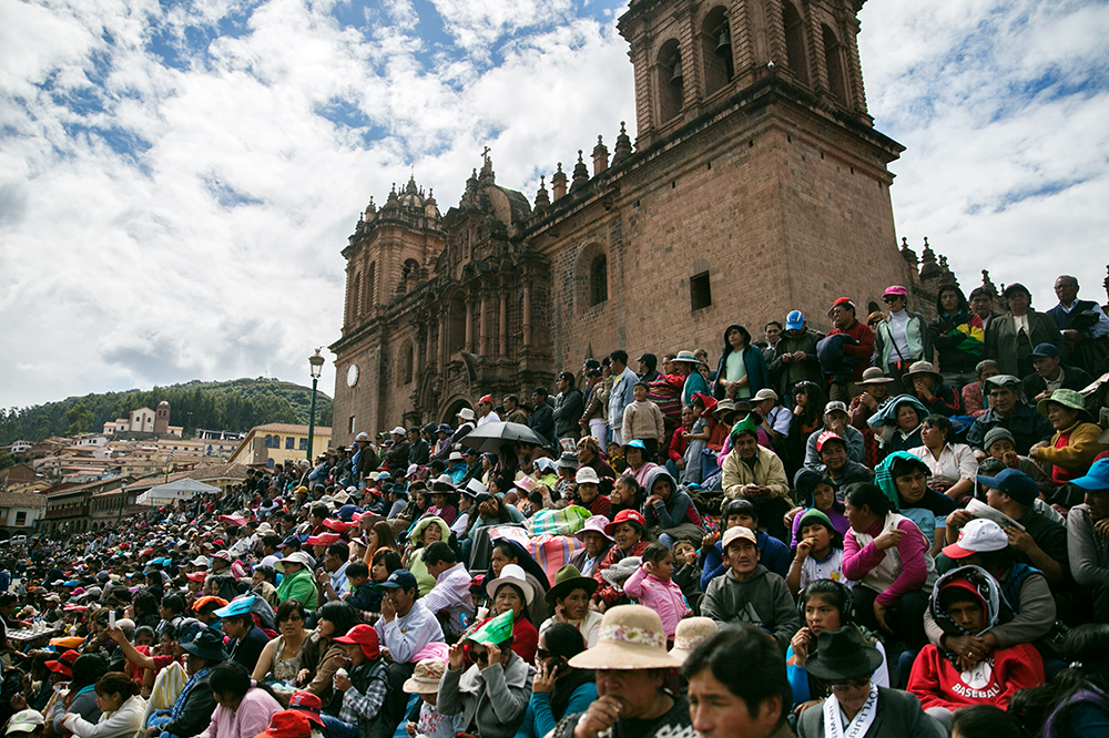 Spectators watch the celebration of Cruz Velacuy in Cusco, Peru.