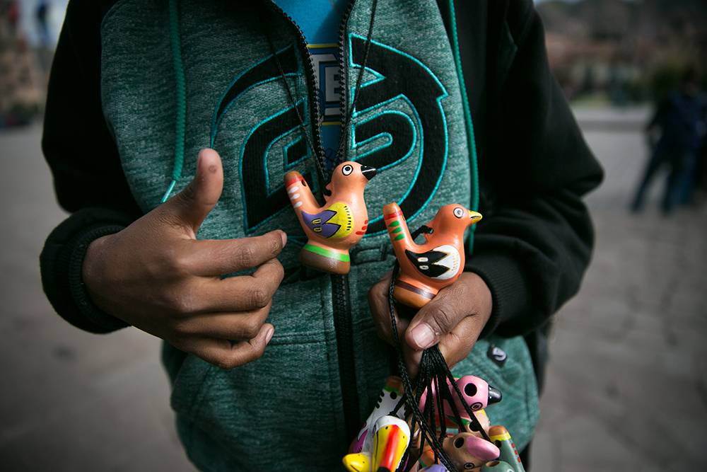 A young boy sells us a bird whistle in Cusco, Peru. Yes, we bought one!