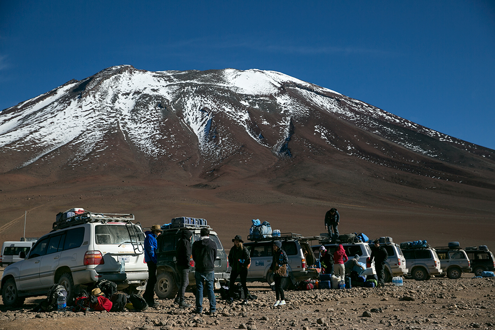 A line of 4x4s load up with tourists and luggage before the three-day crossing from Chile to Uyuni, Bolivia.