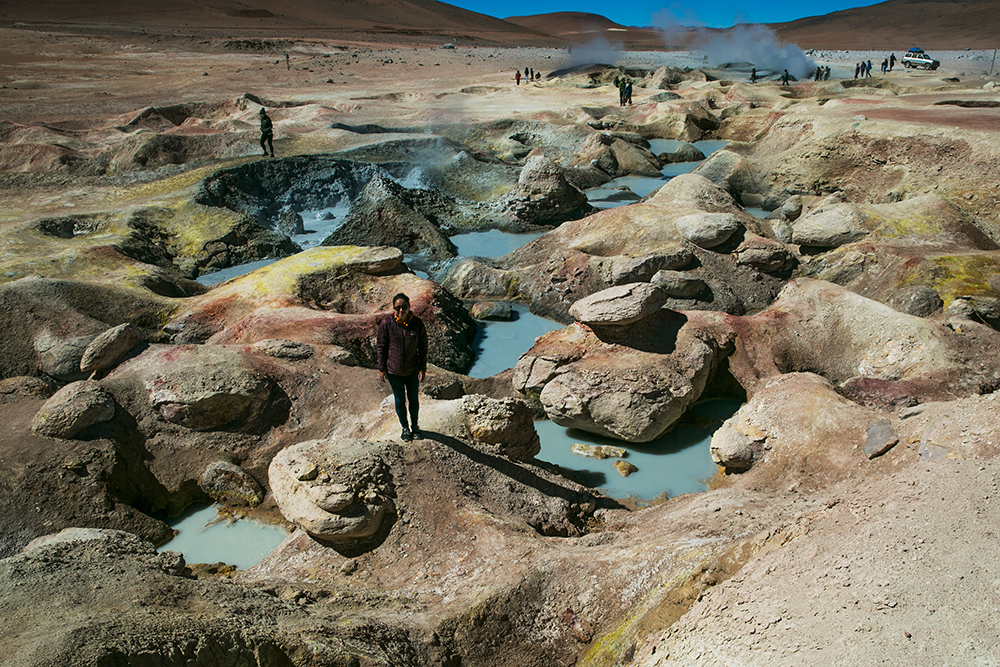 Britnee roams among the bubbling geisers along the way to Uyuni, Bolivia.