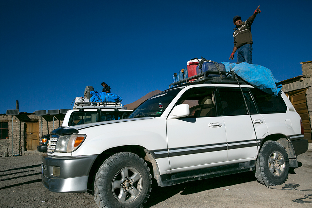 Our driver secures our bags on top of our 4x4 before we started off on day two of our crossing to Uyuni, Bolivia.