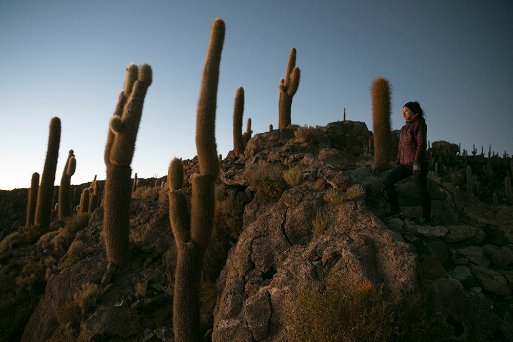 Britnee pauses for a photo as we climbed to the top of Isla Incahuasi to watch the sunrise over Salar de Uyuni, Bolivia.