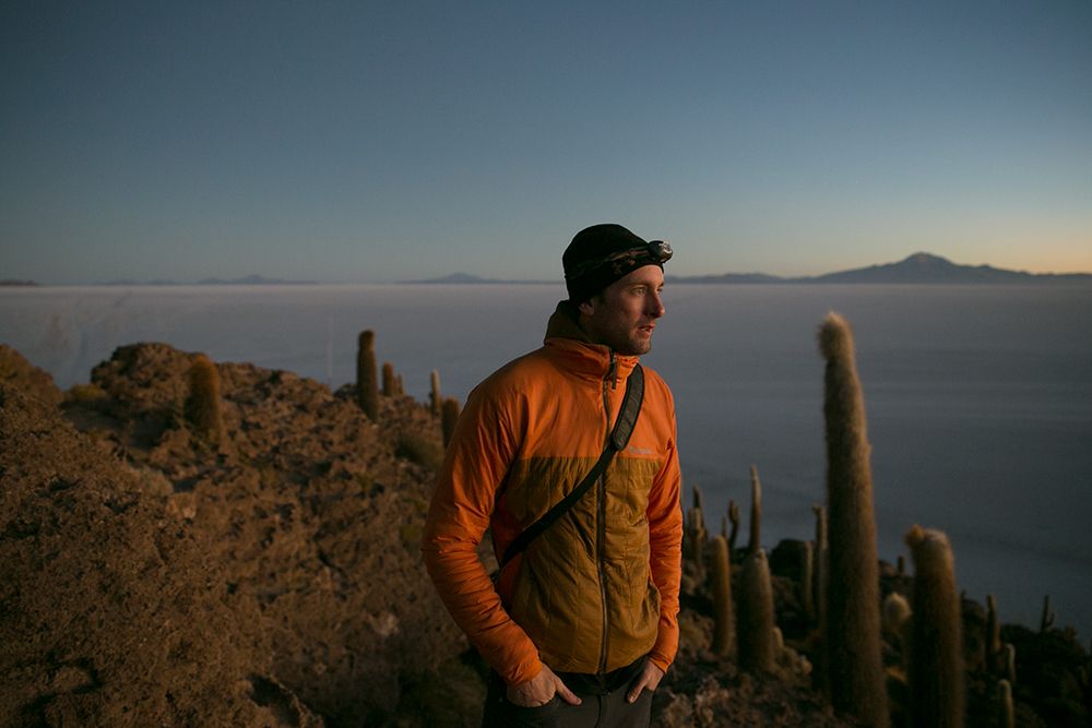 Mark admires the view from atop Isla Incahuasi as we waited for the sunrise over Salar de Uyuni, Bolivia.