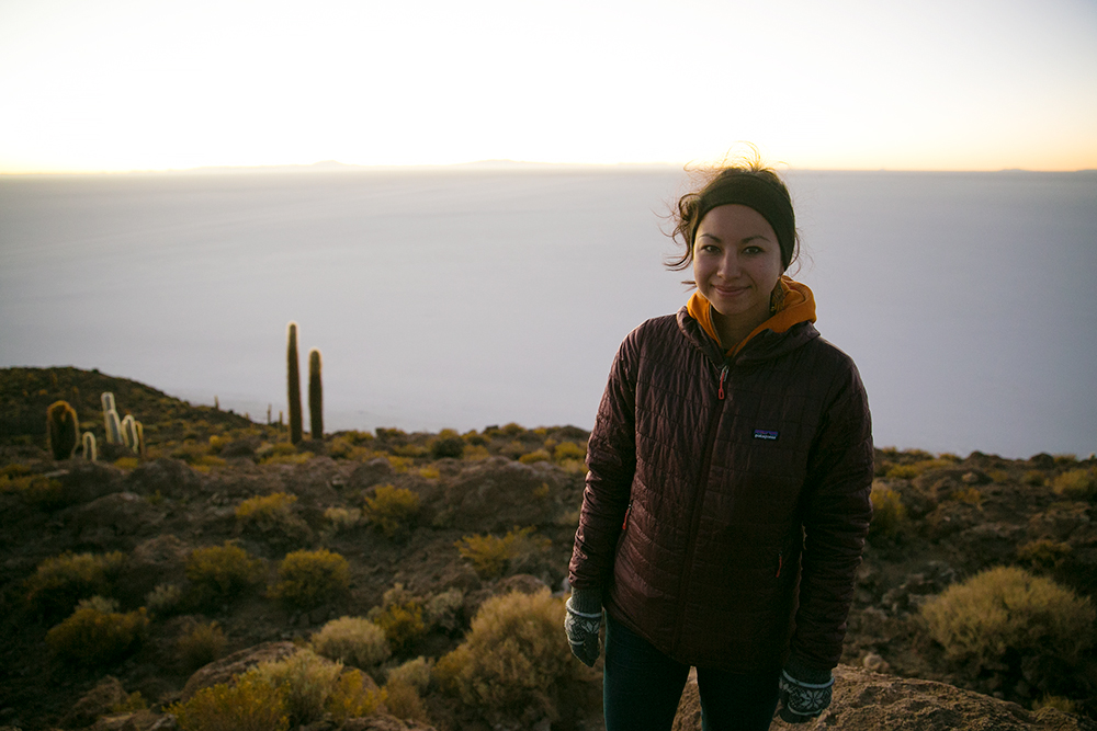 Britnee atop Isla Incahuasi with Salar de Uyuni stretching away behind her as we awaited sunrise on the last day of our 4x4 tour in Bolivia.