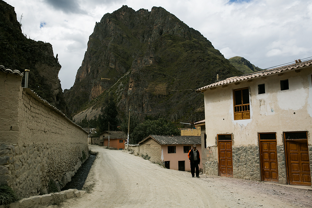 Exploring the village of Ollantaytambo in the Sacred Valley in Peru. You can see some of the many ruins surrounding the town up on the distant hillside.