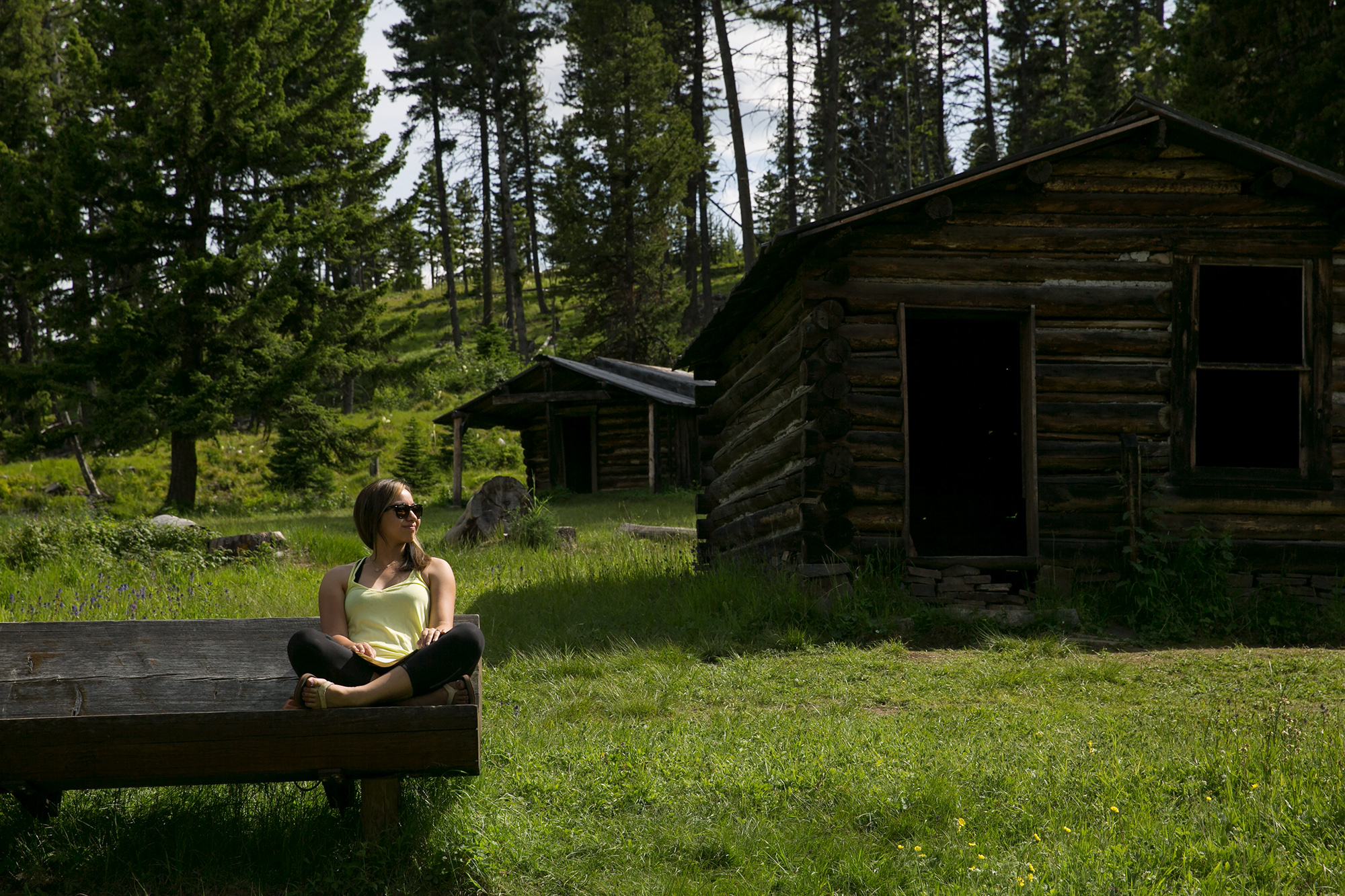 Britnee enjoys a break on a nice bench in the ghost town of Garnet, Montana.