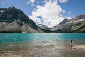 Britnee stands on the shore of Bow Lake in Banff National Park, Canada.