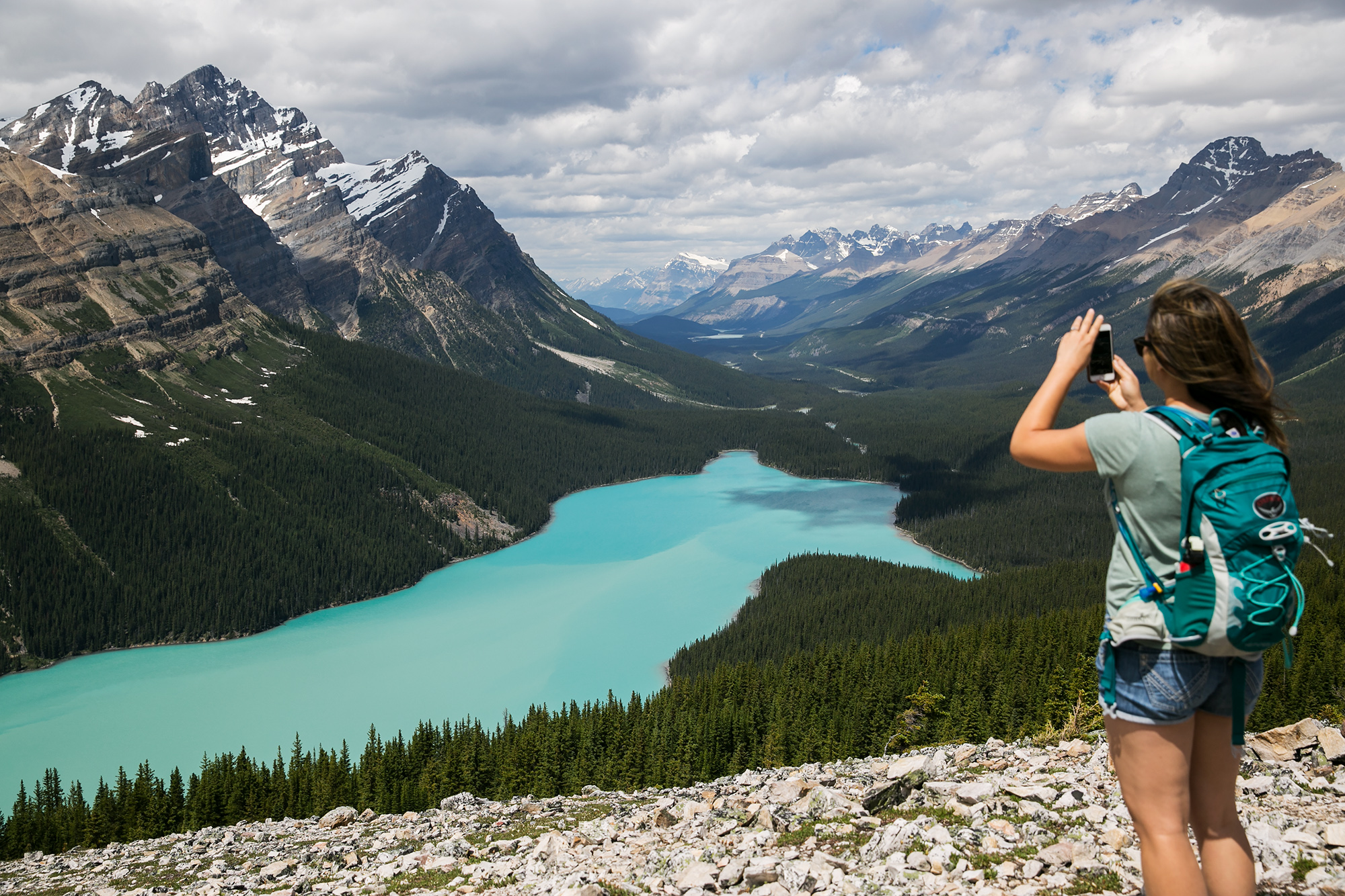Britnee snaps a photo of Peyto Lake in Banff National Park. We walked higher than the crowded viewpoint and were rewarded with a quiet (but windy) spot to take in the view.