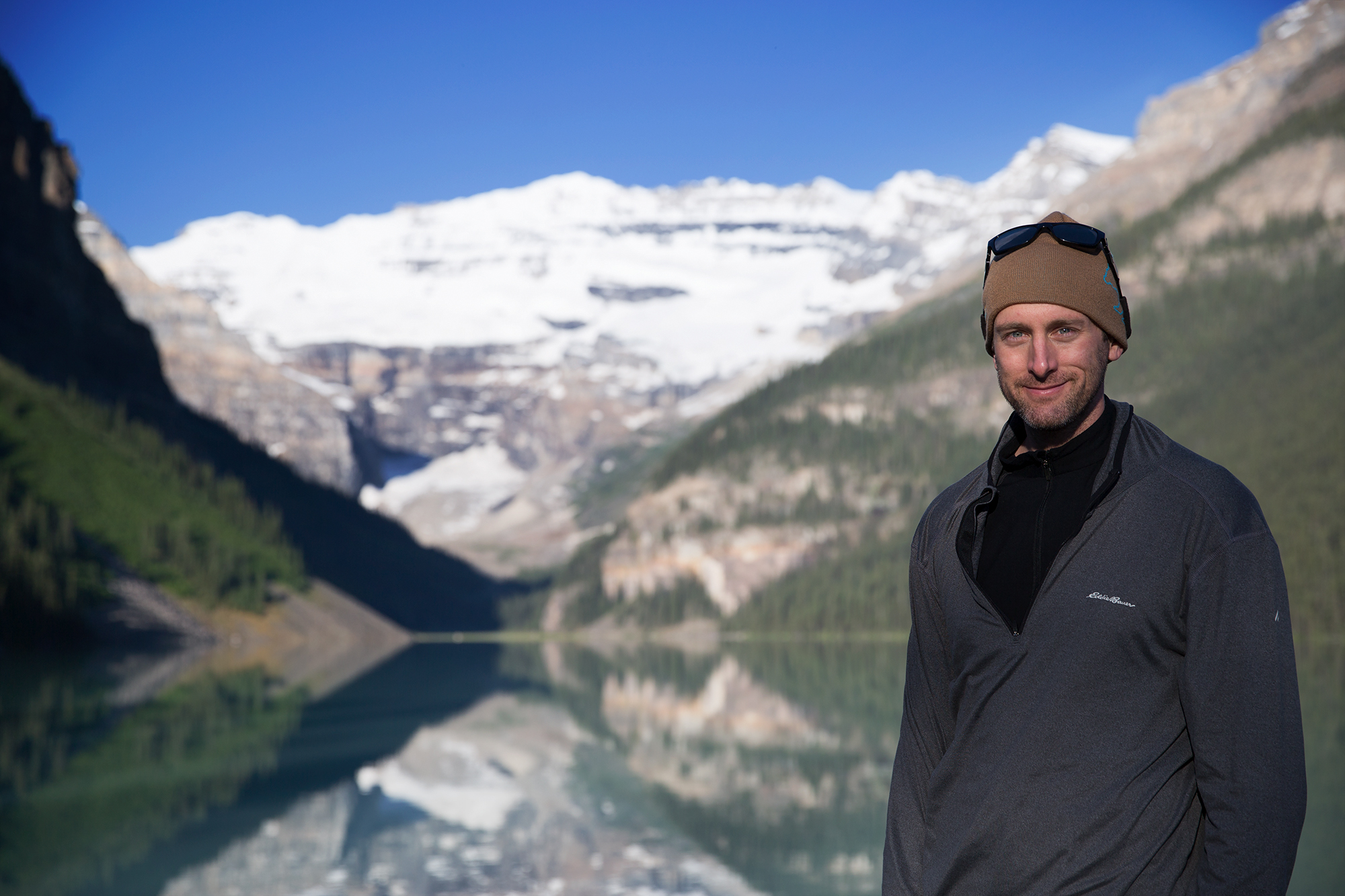 Mark stands for a photo in the morning light on the shore of Lake Louise shortly after sunrise in Banff National Park.