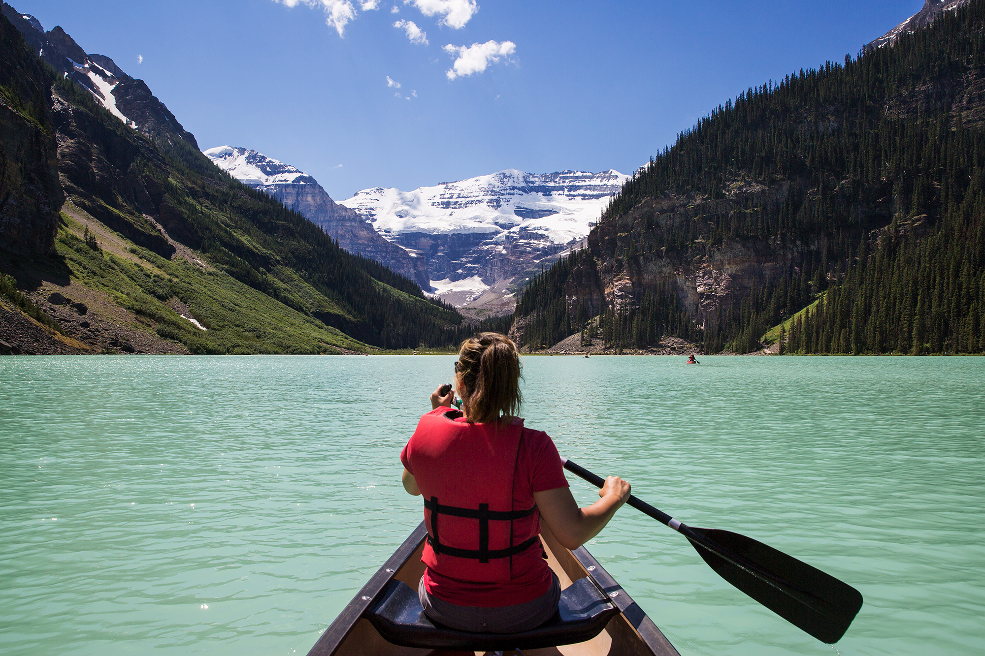 Britnee fulfilling a dream of canoeing on Lake Louise in Banff National Park.