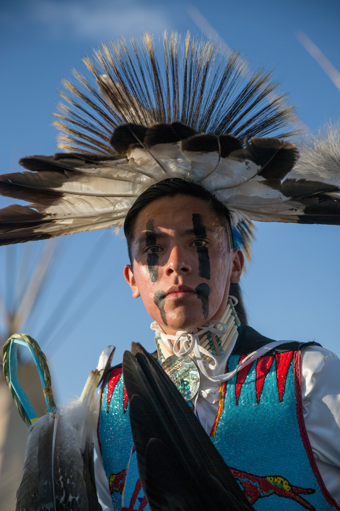 A dancer stands for a portrait before competing at North American Indian Days in Browning, Montana.