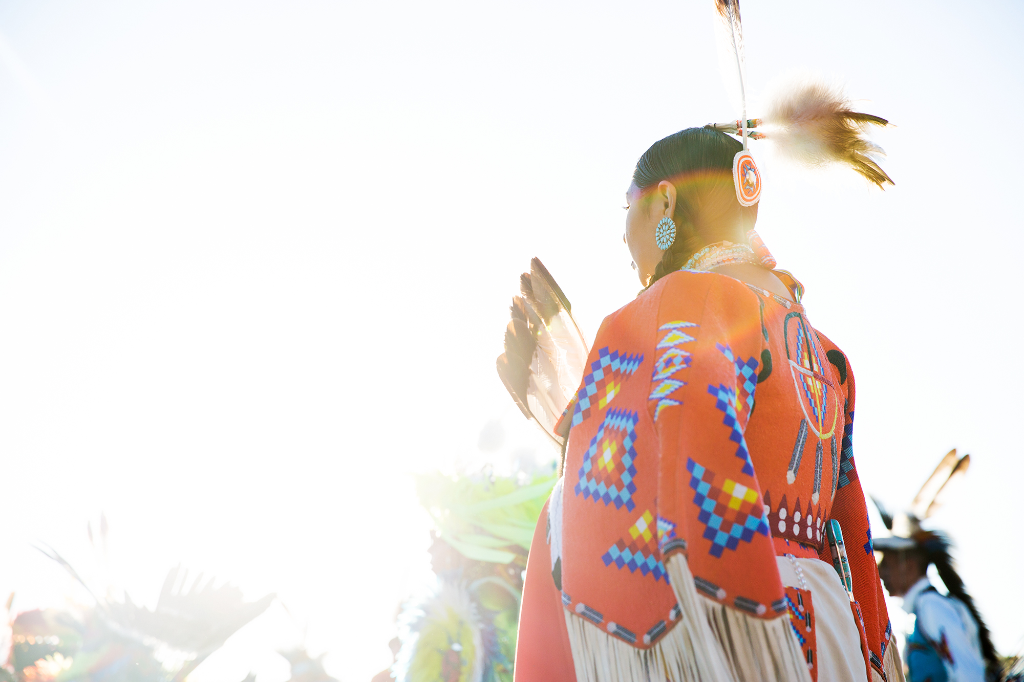Dancers from tribes throughout the U.S. and Canada enter the arena during North American Indian Days in Browning, Montana.