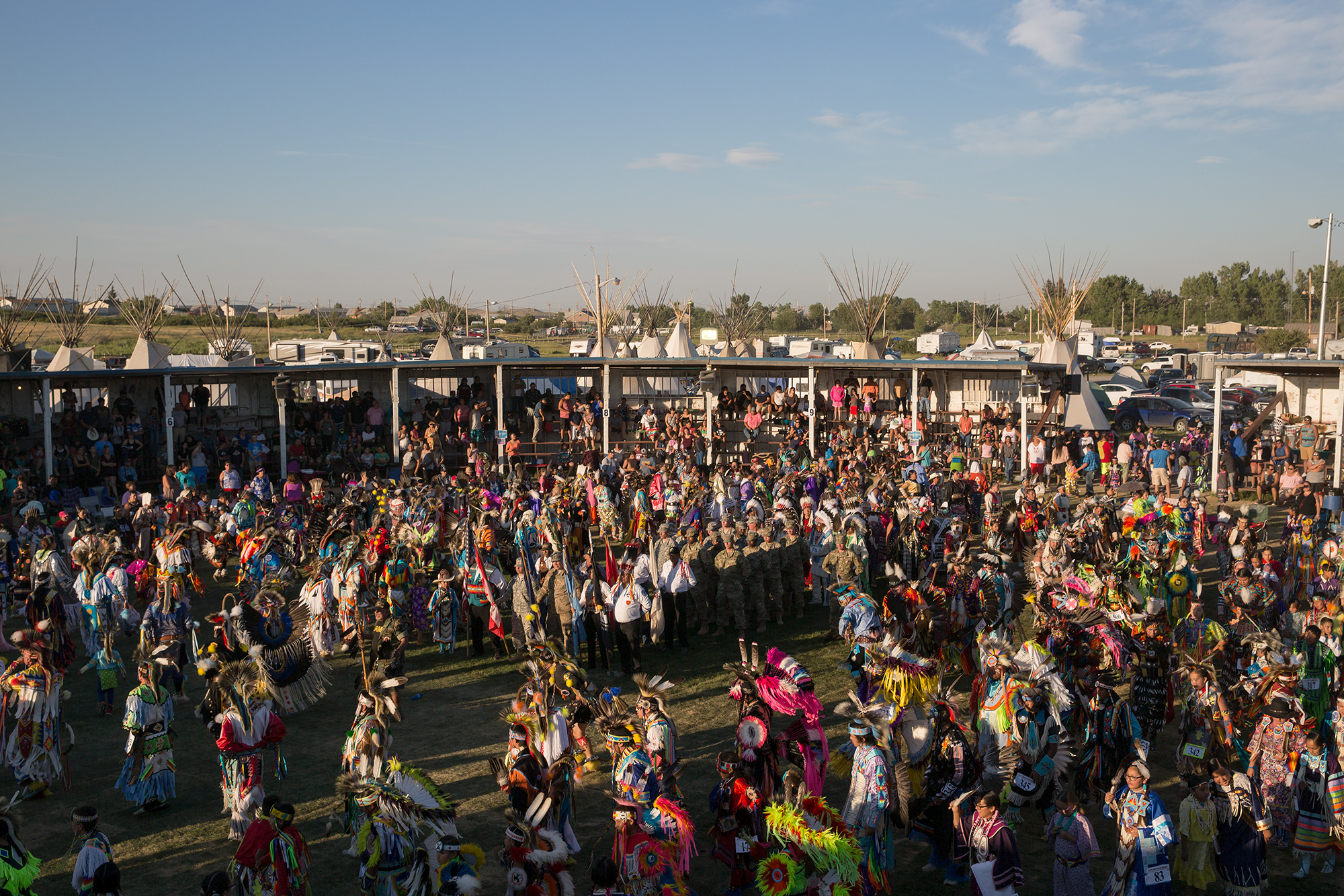A humble arena comes to life with drums, chanting, and dancers during the Grand Entry at North American Indian Days in Browning, Montana.
