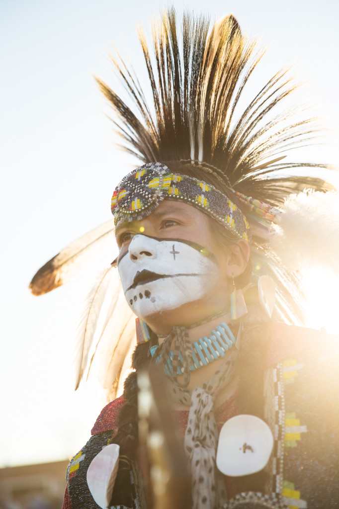 A dancer stands for a portrait after the Grand Entry at North American Indian Days in Browning, Montana.