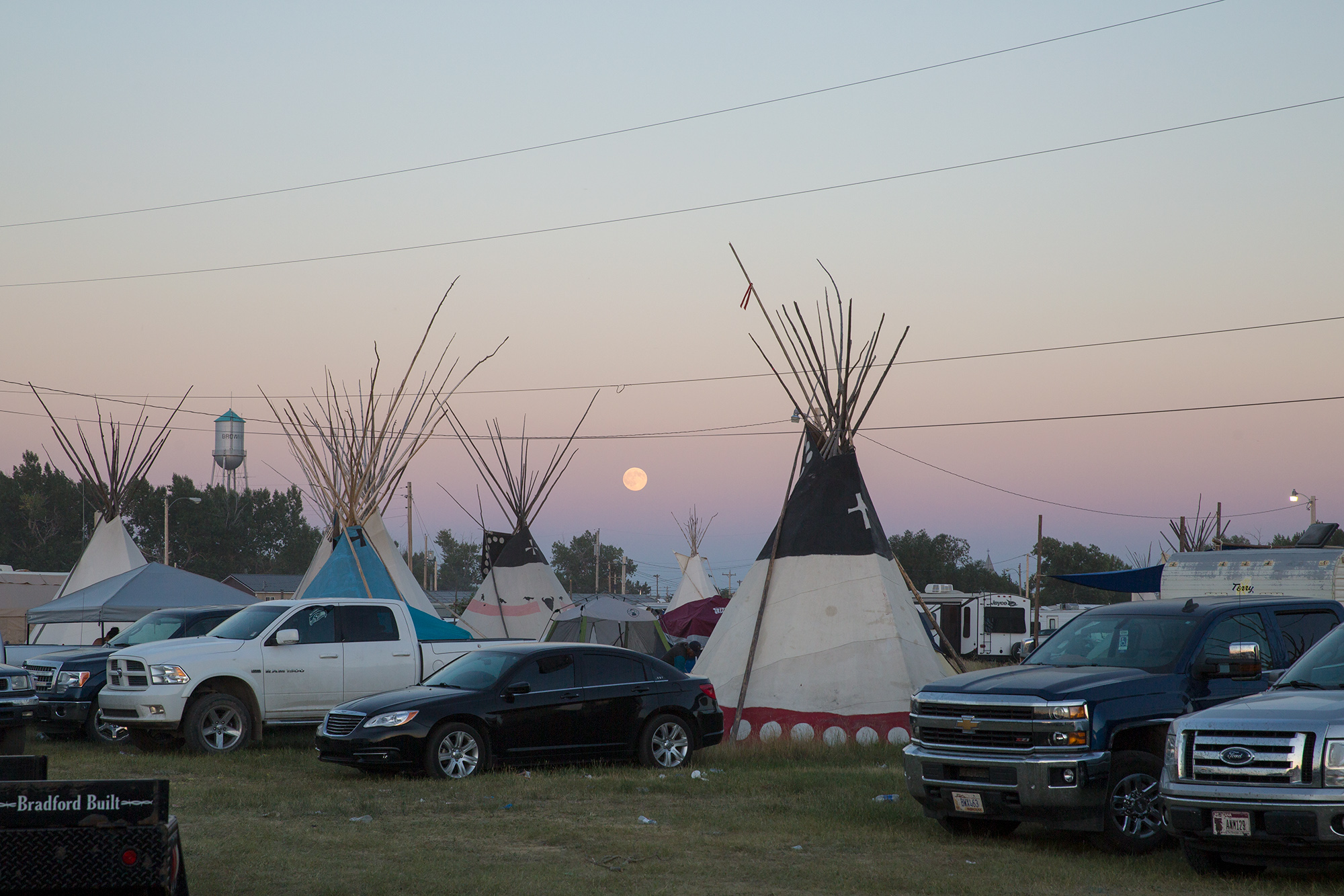 The moon rises as festivities continue at North American Indian Days in Browning, Montana.