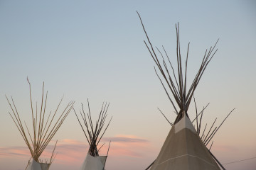 The sun sets as festivities continue at North American Indian Days in Browning, Montana.